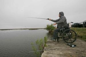 Man fishing in wheelchair